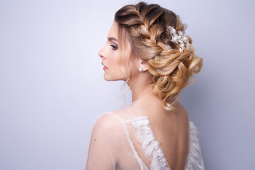 Bride showcasing wedding hairstyle