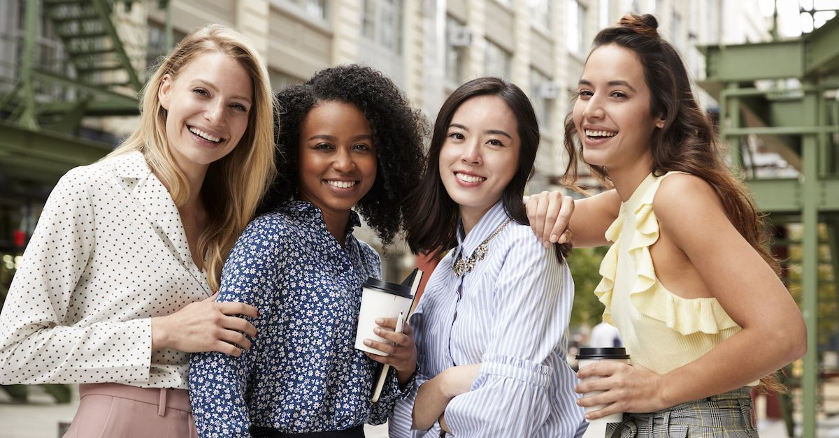 A group of women standing together and socialising